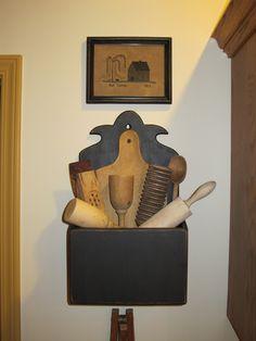 Black box with wooden kitchen utensils.