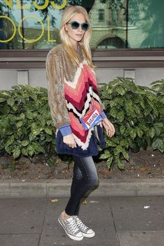 Poppy Delevingne wearing J Brand jeans, #Converse sneakers and an @anyahindmarch bag.