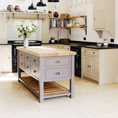 For a pretty kitchen with bags of country charm, turn to feminine shades such as soft aubergines and vintage rose. Don't overdo it - a standout island unit will suffice. Pinks are from the warm side of the colour spectrum, so you can afford to introduce plenty of creamy background shades that will keep the décor on the sophisticated side of 'girly', and the overall look fresh