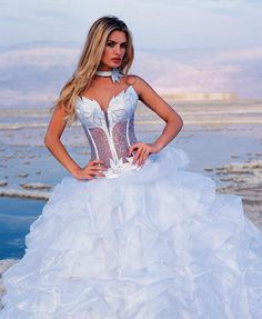 Strapless corset wedding dress with matching choker.  Corset bodice with see through lace, flower caught up skirt.