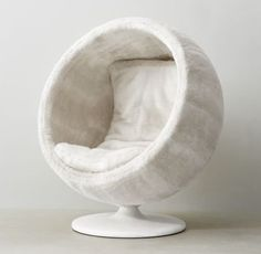 RH TEEN's Orbit Arctic White Fox Luxe Faux Fur Chair:Our spherical, low-to-the-ground lounger gives off a playful interplanetary vibe. Plushly upholstered inside and out with our supremely soft luxe faux fur, it& the ultimate place to land.