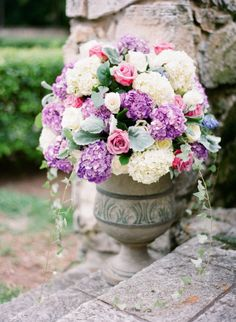 Hydrangea purple and white arrangement with roses