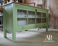TV console with antique window