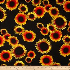 Rayon Challis Dreamer Sunflower on Black from @fabricdotcom  This rayon fabric has a beautiful fluid drape and soft hand. It is perfect for creating shirts, blouses, gathered skirts and flowing dresses with a lining. Colors include orange, yellow, maroon, grey and black.