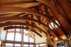 Eagle Crest Estate  The massive great room features one piece arched beams, imported from Canada, and ceiling to floor windows.