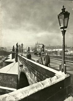 Prague, Charles bridge, written date 1967. The Charles Bridge (Czech: Karlův most [karˈluːf ˈmost]) is an historic bridge that crosses the Vltava river in Prague, Czech Republic. Its construction started in 1357 under the auspices of King Charles IV, and finished in the beginning of the 15th century. The bridge replaced the old Judith Bridge built 1158–1172 that had been badly damaged by a flood in 1342.