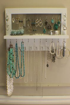 *****This is a MADE TO ORDER listing. You will receive a jewelry organizer the same as the one pictured above but this one already has a home.***** This listing is for a wall mounted jewelry organizer just like the one pictured above. There is plenty of room for all you jewelry storage needs. It is painted with four coats of white paint so it is very durable and will last. The shelf on the front is large enough for any additional jewelry you dont want to hang from any of the many hooks…