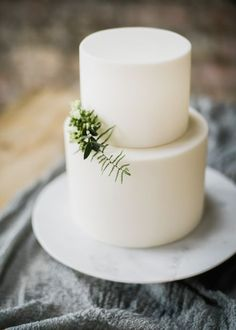 Elegant White Wedding Cake With Foliage - Halfpenny London Wedding Dress | Clemence in Blush | Elegant & Minimal Wedding Inspiration From The Forge Bristol | Ruby & The Wolf Floral Design | John Barwood Photography #modernweddingcakes