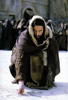 """John 8:6-8  6 They were using this question as a trap, in order to have a basis for accusing him.  But Jesus bent down and started to write on the ground with his finger. 7 When they kept on questioning him, he straightened up and said to them, """"Let any one of you who is without sin be the first to throw a stone at her."""" 8 Again he stooped down and wrote on the ground."""