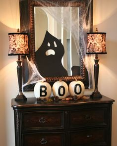 Cute and Simple BOO Entry Table - stencil b-o-o on pumpkins, add black poster board haunt to mirror & drape with gauze or cheesecloth!