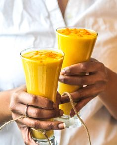 Mango Turmeric Lassi by chocolateforbasil: Dairy free, the turmeric root in this lassi adds a kick of spice to complement the mango.  It'll have your tastebuds fulfilled from the first sip! #Lassi #Mango #Turmeric #Dairy_Free #Healthy_Drink