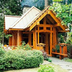 "Tiny little craftsman house, referred to as a ""shed"" but it has a fireplace! And a metal roof, and lots of windows! Would make a good art studio... via http://www.smallgardenlove.com/beautiful-garden-sheds/   Another entry in the **In the back yard of my dreams,  there is this studio**"