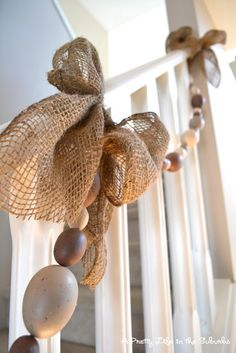 easter egg & burlap staircase garland...love this, but maybe use Christmas balls instead of eggs????