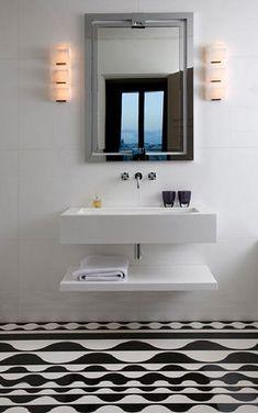 simple floating shelf under wall hung basin