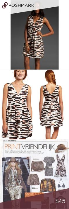 OFFER!✨SILK✨BB Dakota Camden Safari Dress SALE✨As seen in Grazia✨With bold brushstrokes of black and white, accented with vibrant vermilion, the Camden dress is a luscious silk statement dress that will seamlessly transition through seasons. In summer, the Camden dress pairs perfectly with lace up espadrilles and bare legs, while in the cooler months it could easily be styled with opaque black tights and red pumps. Silky graphic zebra print dress with plunge front Pleating along waist seam…