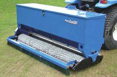 """The Raycam Aeraseeders are a range of heavy-duty """"2-in-1"""" overseeders designed for overseeding greens, tees, sports fields & other similar fine turf surfaces, with minimal disruption to the existing sward. The unique angled coned rollers produce approx. 1750 holes per sq. metre, and the rear mounted brush ensures that seed is swept into the holes created by the coned roller. The hopper has an internal agitator to ensure a smooth seed flow and a floating headstock ensures good contour…"""