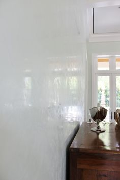 Venetian plaster in glossy white for a bright airy interior by Rich Coulter of Coulter Designs.