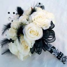 Black And White Bridal Bouquets With Feathers Ideas USE PURPLE FLOWERS MAYBE GOLD BOW AND PURPLE FEATHERS