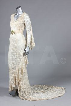 1930s bias cut ivory lace bridal gown with long trained skirt, pearl beading to bust area