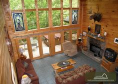 RIVER'S EDGE - This beautiful handcrafted cabin features hand rubbed light pine throughout, designer furnishings and a 20' high glass wall overlooking the river. #petfriendly #cabin #JMH
