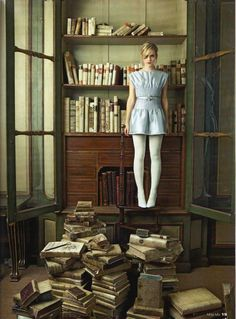 """Emma Watson (1990-) with books. Yo Dona Magazine, Spain. June 2009. The release of Harry Potter and the Sorcerer's Stone (2001) was Emma's cinematic screen debut. The film was the highest-grossing film of 2001. Critics praised the film and the performances of the three leading young actors. The Daily Telegraph called her performance """"admirable"""". Later, Emma was nominated for five awards for her performance in the film, winning the Young Artist Award for Leading Young Actress in a Feature…"""