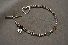 The purchase of these bracelets provides funding to the Foundation of Hope and Grace that gives grants to adoptive families