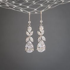 Original Design by Glamorous Bijoux® This listing is for the HARRIET earrings - Dramatic wedding earrings feature a vintage style design. Created with varied sizes of pear cut cubic zirconia and marquise cut cz set in a clover leaf shaped setting. Carefully hand-placed onto a