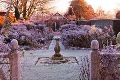 Wollerton Old Hall, Shropshire: Winter Garden In Frost - View To Wooden Pergola Along Frosted Path And Borders With Stone Sundial - Dawn Light Postcards, Greetings Cards, Art Prints, Canvas, Framed Pictures, T-shirts & Wall Art by Clive Nichols