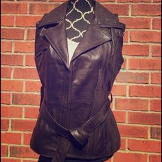 HOST PICKNWT ELIE TAHARI Lamb Leather Vest You will love this gorgeous and brand new with tags chocolate brown lamb leather vest. 100% authentic. Can provide more pictures upon request! Last picture is to show style of this great vest! GET THE LOOK!  Tahari Jackets & Coats Vests
