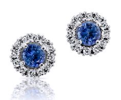 Sophistication, grace and beauty. These are the word that will come to your mind when you will see these round halo earrings with 2 sapphires and 24 diamonds.