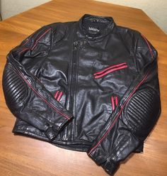 Nice soft black leather that was well taken care of. No cracking or stiffness! Nice clean liner as well. Size 40 chest. Use all measurements given in the pictures. Nice red color accents and piping.