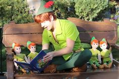 Peter Pan at Disneyland. Look the most awesomest person in the world is reading to himself.