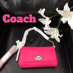 """Ruby Coach Crossbody⬇️ Adorable pop of color cross body bag. Leather. Brand new from Coach. Great gold hardware. 20"""" gold chain strap drop. A pink long leather strap is also included. Turn lock closure. Inside multifunction pocket.  Just perfect! I don't want to unwrap this gorgeous bag but I added a third photo ( w/ other colors) to show the interior and how it hangs from the shoulder. Coach Bags Crossbody Bags"""
