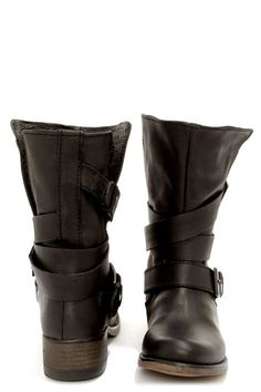 "Let your online shopping come to fruition 'cause we can clearly see you're cruisin' for the ""Brewzzer""! The Steve Madden Brewzzer Black Leather Belted Mid-Calf Boots feature a genuine leather round-toe upper that will carry you through boot season and beyond. A 9"" tall split shaft is strapped with wraparound belts and silver, antique-finished buckles for a cool slouchy effect. 1.25"" stacked heel. Cushioned insole. Non-skid rubber sole. Available in whole and half sizes. Measurements are for…"