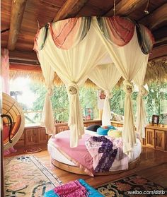 round bed with draped canopy: if I ever had the space...