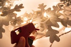 Transform snowflake ornaments from the dollar store into a beautiful glowing wreath you can use all winter.