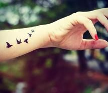 A cute small bird tattoo