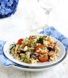 Orzo Salad with cannelloni beans, tomatoes, olives  feta - A great dish to make on a weeknight to bring to work for lunch!