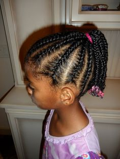 Cornrows into ponytail.