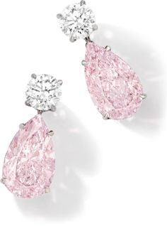 Exquisite Pair of Fancy Pink Diamond and Diamond Pendent Earrings. Each set with a pear-shaped fancy pink diamond weighing 5.21 and 5.01 carats respectively, to the brilliant-cut diamond top each weighing 1.01 carats, mounted in platinum, post and sprung locked fittings.