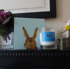 Dusk scented candle and our popular Rabbit greeting card sitting on our mantelpiece. Both available to buy on www.pheasantpluckerandson.com