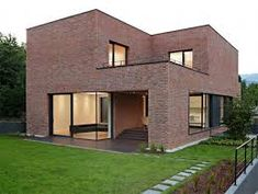 Brick house exterior its intriguing to see a modern house done completely in brick travel in . Modern Brick House, Brick House Designs, Modern Family House, Brick Design, Modern House Design, Brick Houses, Brick House Plans, House Design Photos, Brick Facade