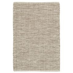 What could be more versatile than this tri-toned neutral woven cotton area rug? Handwoven with mixed brown, grey, and ivory cotton yarns, this rug has a subtle pattern that blends perfectly in neutral rooms throughout the home.