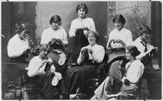 Members of the Spinsters Club knitting socks for World War I soldiers. Shows a group of women in Wellington. From left: Miss Daisy Isaacs, Mrs V Gr.