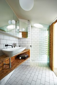 wood + white tile bathroom