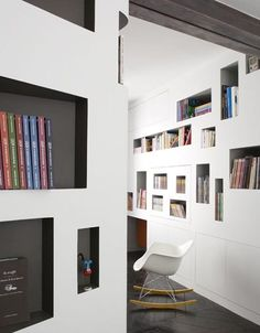 """Library"" Loft Condo. Walls which look like bookshelves"