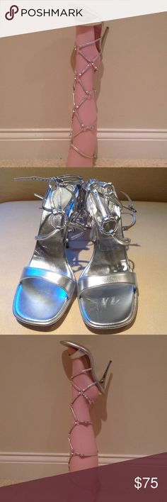 Silver CASADEI Gladiator Heeled Sandals WOW This is a super unique pair of sexy heeled gladiator style heels. These are in great shape with minimal wear. There are four sets of straps that buckle. No dust bag. Casadei Shoes