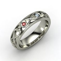18K White Gold Ring with Birthstones in it. This would make the perfect wedding band, and you could get a matching one for him that is bigger! This just makes my heart jump!