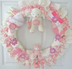 Diaper Wreaths & Diaper Cakes...if you feel up to the challenge, you could totally do this on your own. http://media-cache1.pinterest.com/upload/230739180878058150_hjnl2O9O_f.jpg coralee shower party ideas