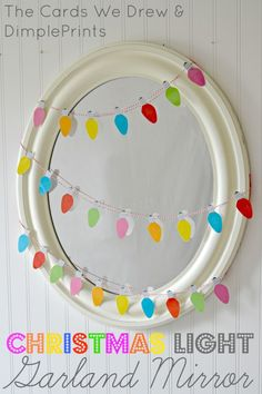 Christmas Light Garland Mirror with Free Printable from DimplePrints -- Simple but bright and happy   http://www.iheartnaptime.net/christmas-light-garland-free-printable/